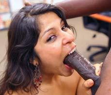Latin slut sucking a big chocolate bar