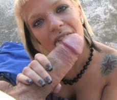 Cutie sucks a huge cock in the street