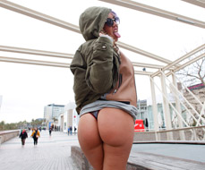 Showing her ass on the street to fuck