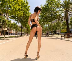 Spanish brunette shows off her ass in public